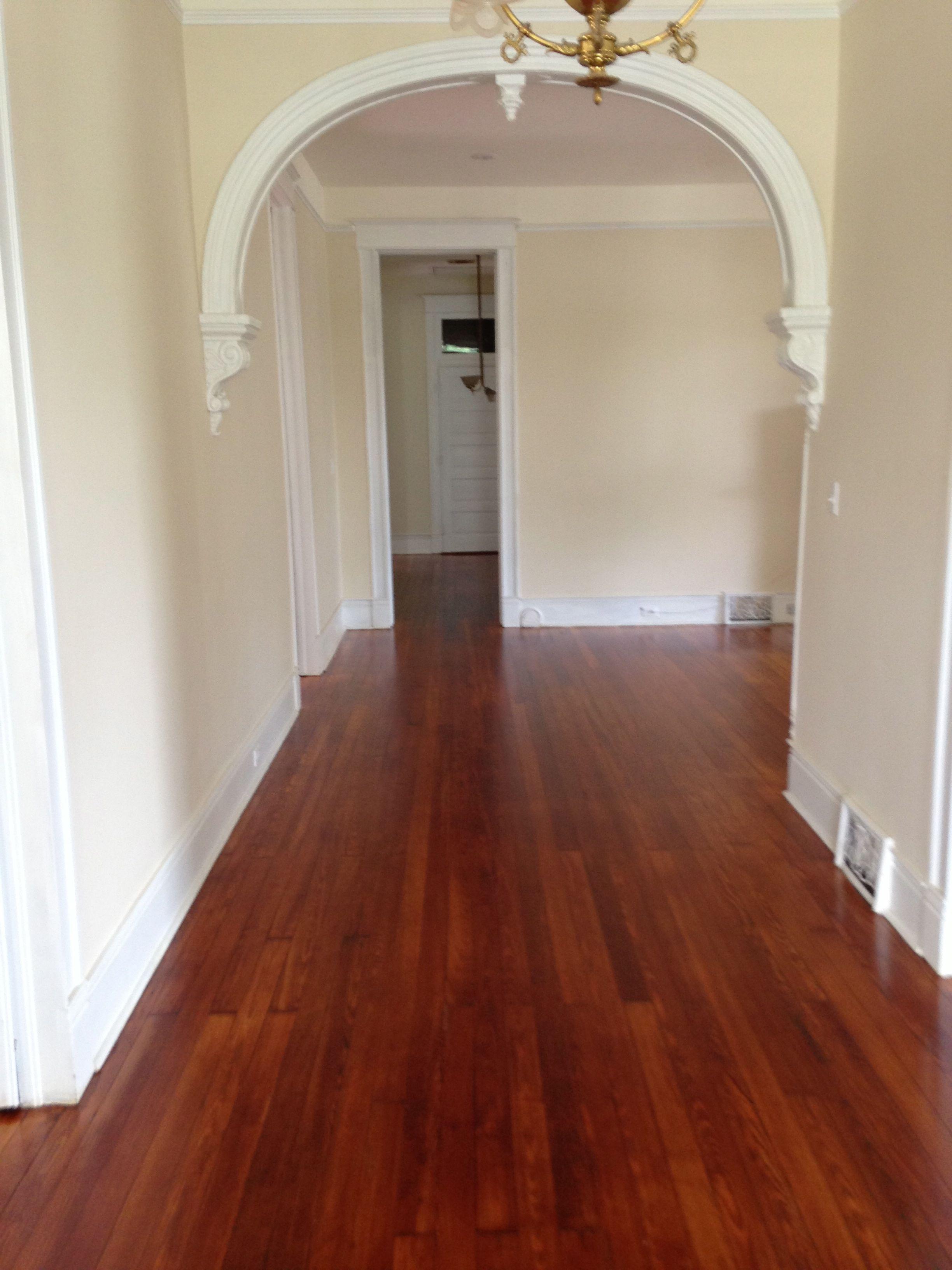 Polyurethaned hardwood floors in an arched hallway