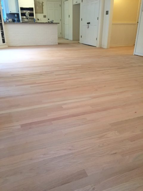 Photo of sanded new flooring after tile removal.
