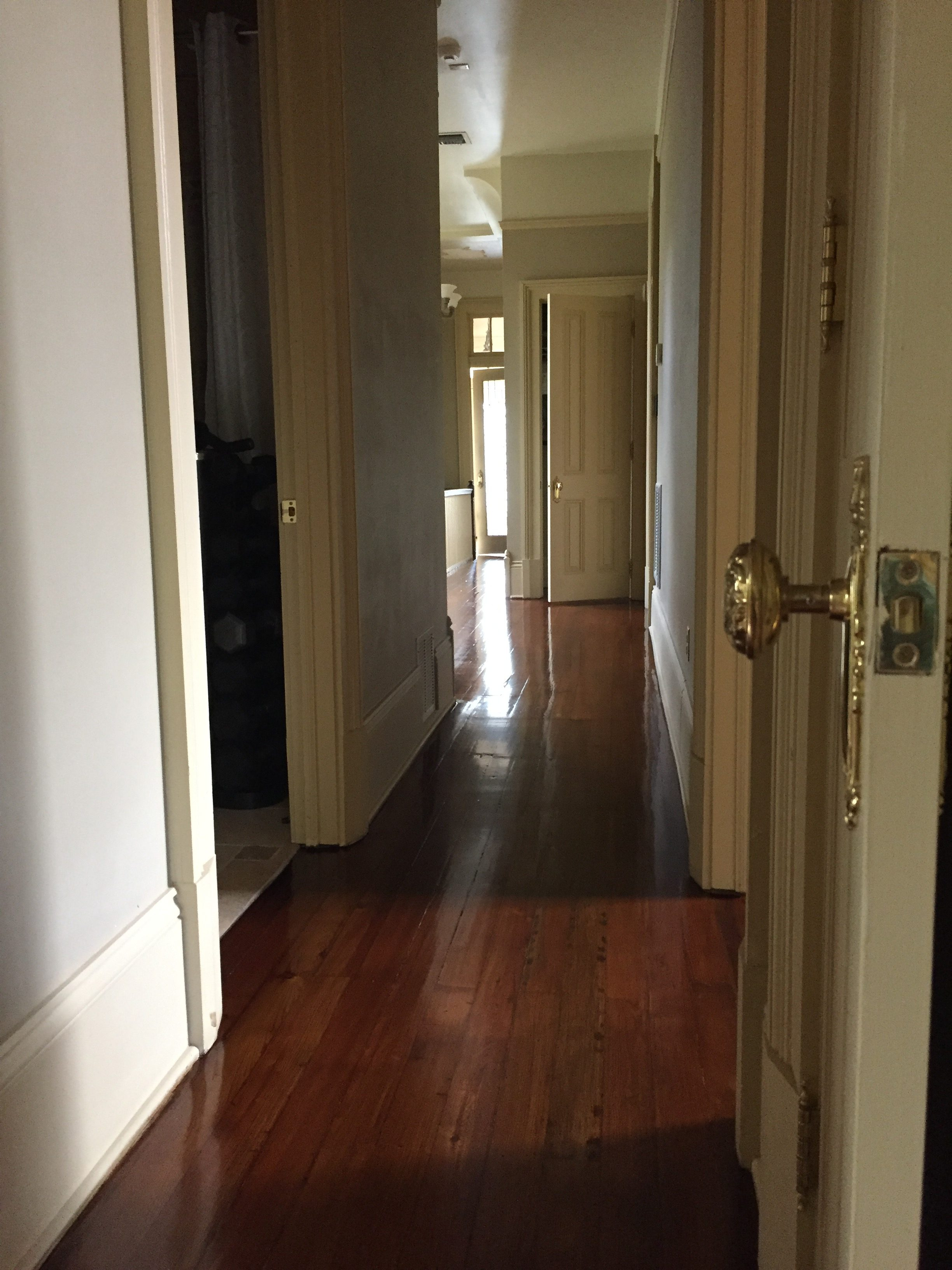 This is a hallway of refinished hardwood pine floors.