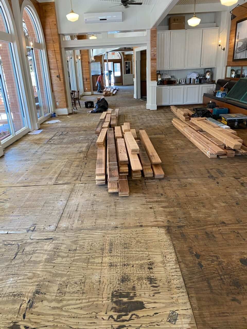 Photo of demoed wood flooring in a restaurant.