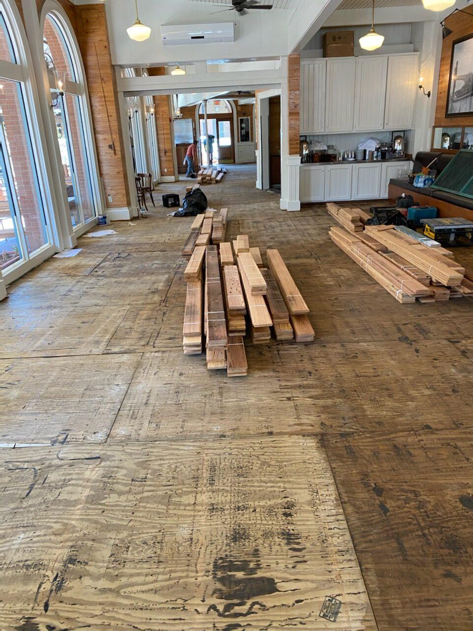 Photo of demoed wood flooring in a restaurant.