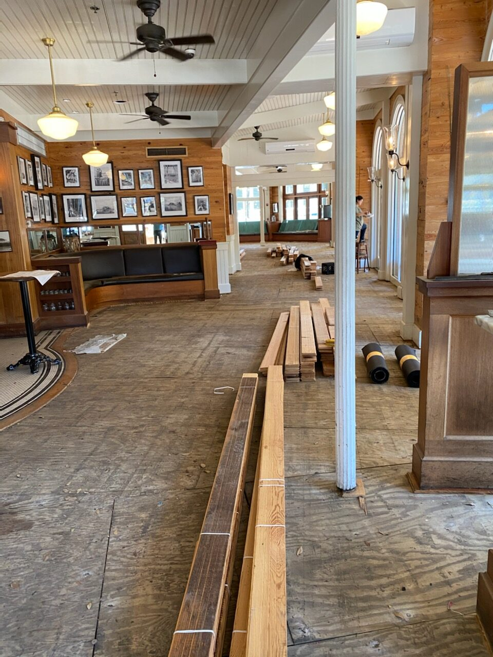 Photo of subflooring in a restaurant. New wood acclimating to be installed.