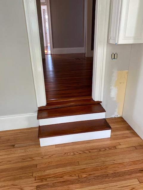 Refinished Red Heart of Pine and Red Oak Hardwood Flooring joined by red heart of pine stairs dropping into the split level