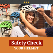 Woman buying helmet and checking the fit for safety