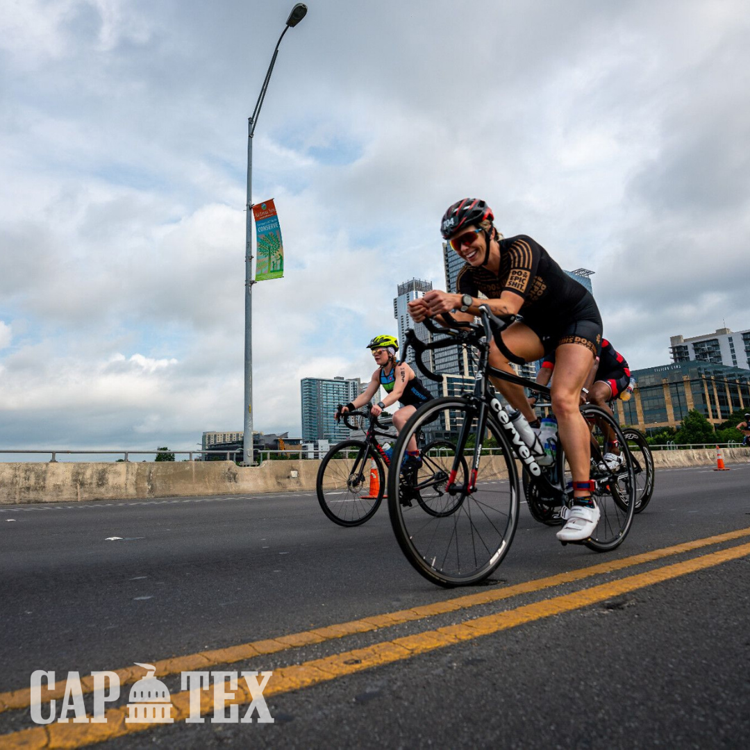 Cyclists cross the South 1st Street bridge during the CapTex Tri.