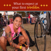 Female triathlete sets up her area in transition before a triathlon. Text on design reads What to Expect at Your First Triathlon. Learn more at https://captextri.com/your-first-triathlon/