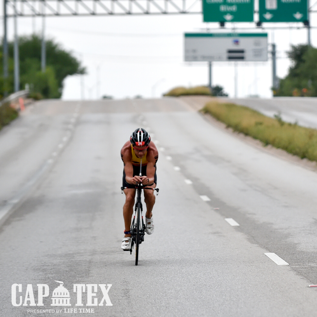 Cyclist rides on a stretch of Cesar Chavez Street during the CapTex Tri.