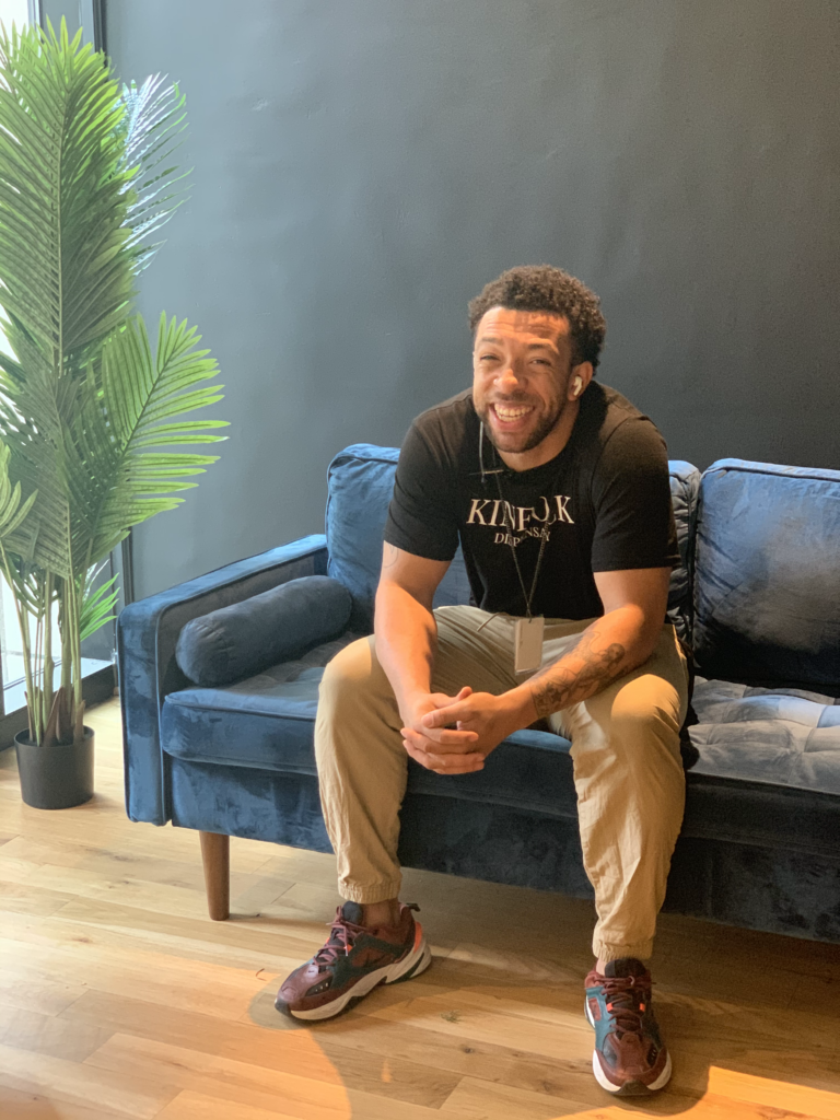 man smiling on couch