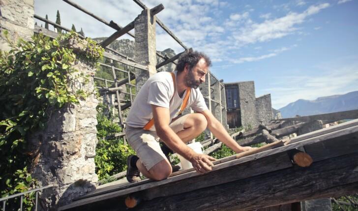 man repairing his roof