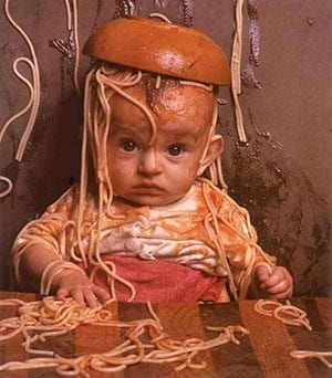 baby covered in pasta and sauce