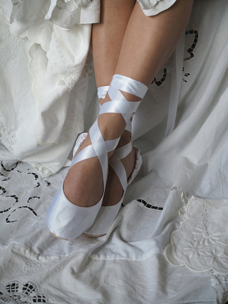 white ballerina shoes with ribbon