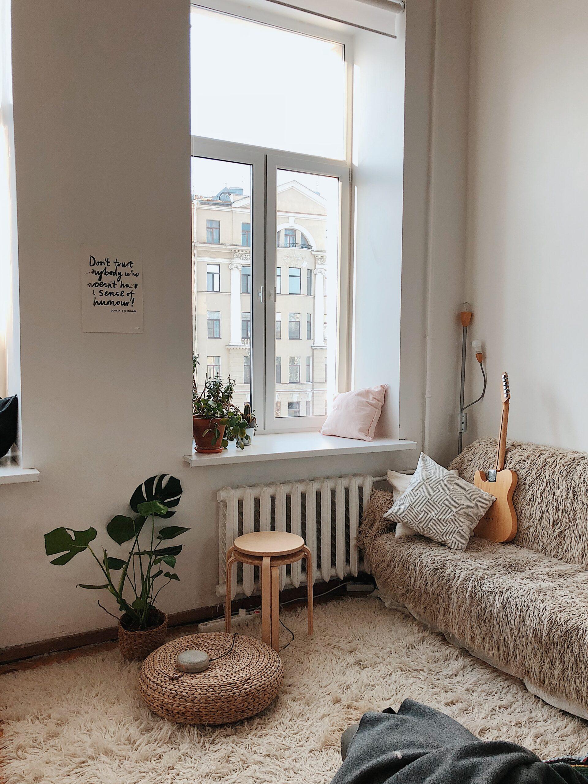 round-brown-wooden-stool-near-brown-sofa-892618