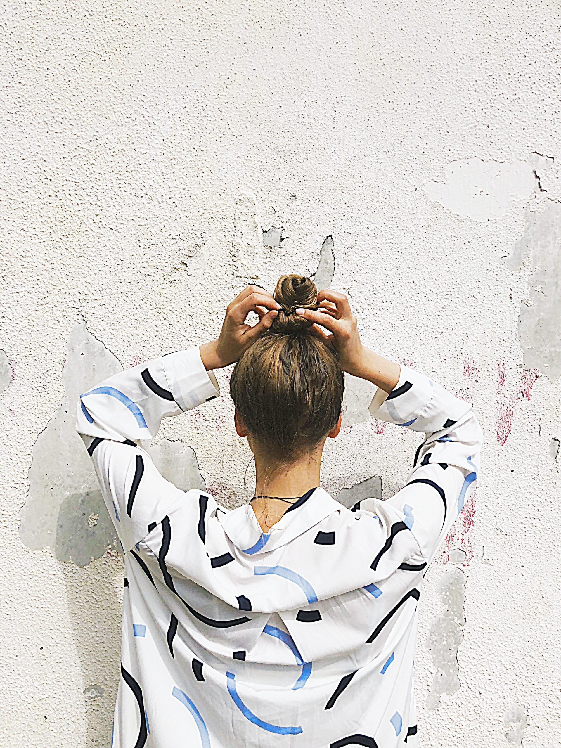 woman-holding-pony-tail-1356299