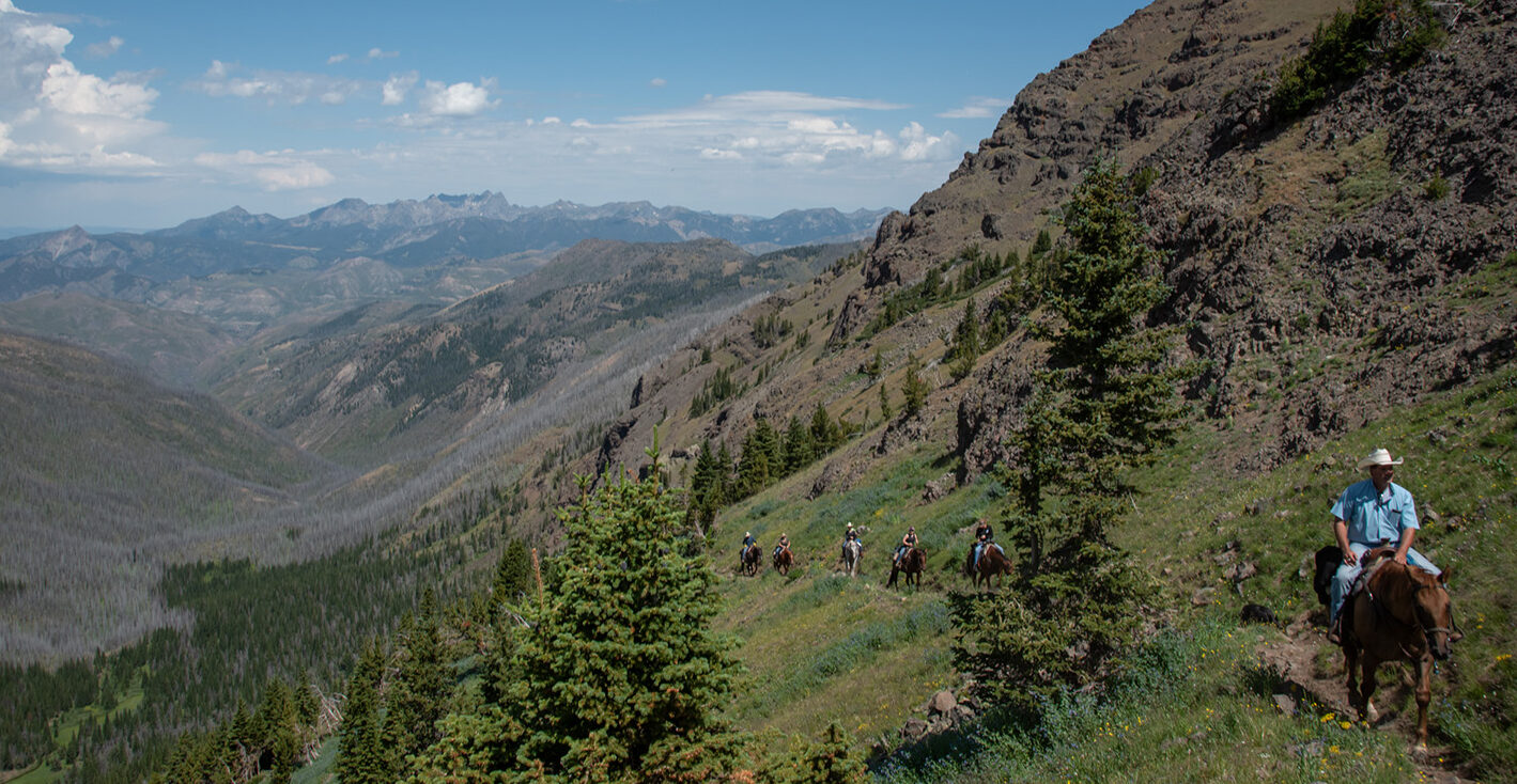 Guests ride up over Wallace Pass on their way to our Grizzly Creek camp.