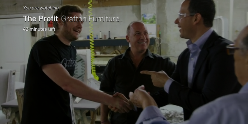TV show host and guest shake hands