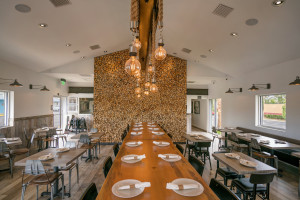 dining room with wood wall