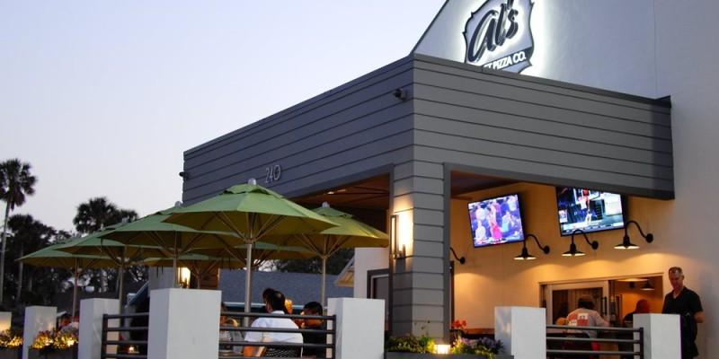 exterior of Al's Pizza at twilight