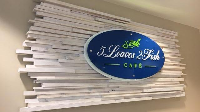 beautiful wooden sign for 5 Loaves 2 Fishes Cafe