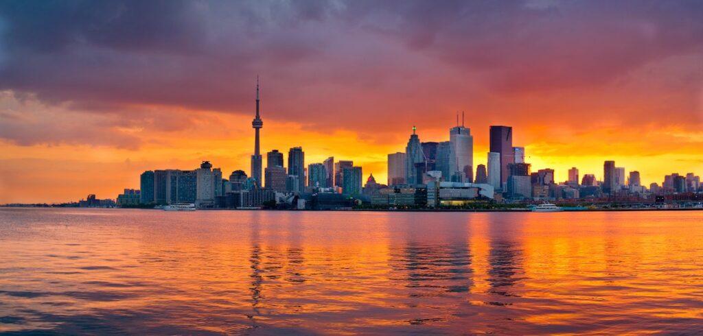 Toronto skyline across the water at sunset