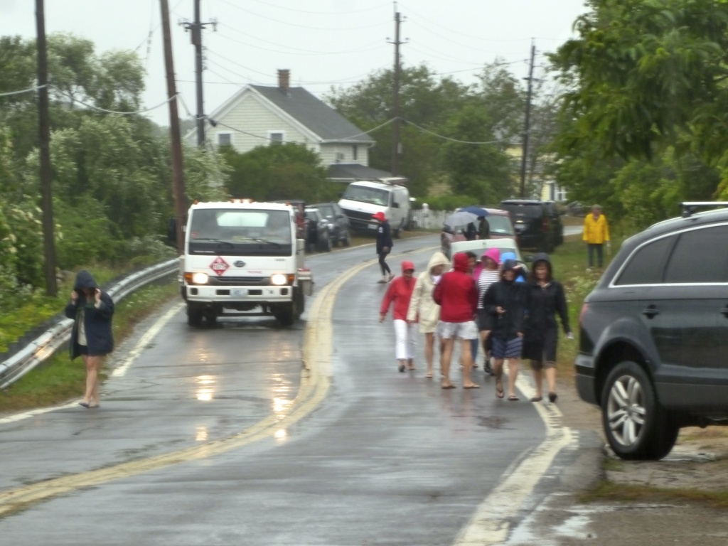 People braving the rain on the rain on the way to our house....