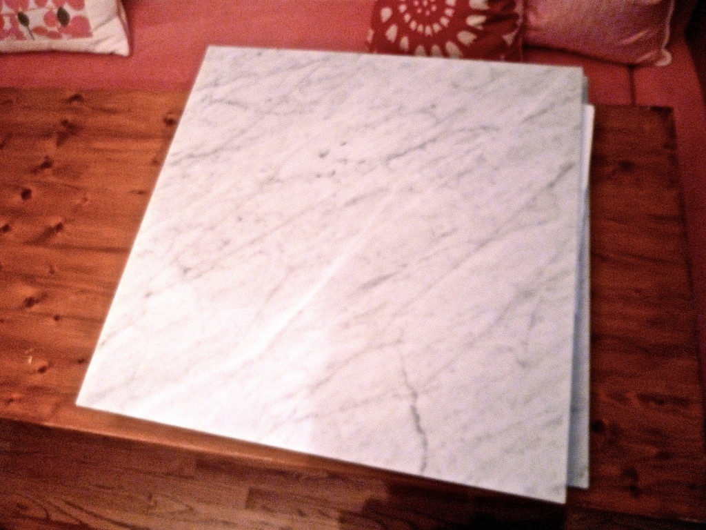 "Two 30"" x 30"" pieces of Carerra marble"