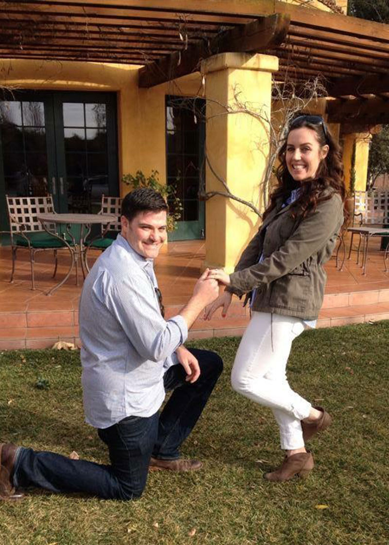 Couple getting engaged at winery