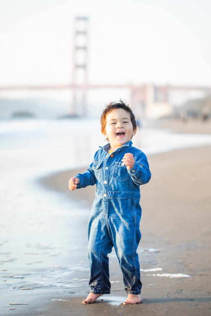 kid playing ta Baker Beach