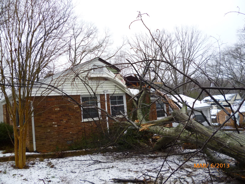 Storm dameage of crushing side of house