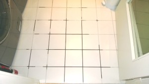 repairing the grout in the laundry room