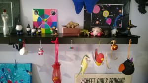girl cave art shelves with paintings, ornaments, and bells