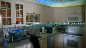 kitchen with tin backsplash, cloud wallpaper on ceiling, new stainless dishwasher