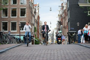 watching people commuting by bicycle in amsterdam