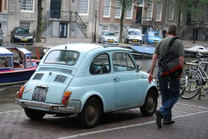 my brother seth verry looking at an old fiat in amsterdam