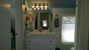 new brushed nickel LED vanity light bar installed in master bathroom
