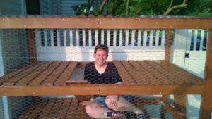me sitting inside the outdoor cat enclosure / catio, installing ramps!