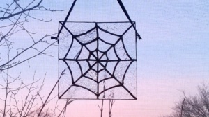 diy stained glass spider web hanging in living room window