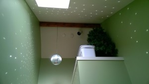 disco ball reflections / sparkles / polka dots in the upstairs hallway