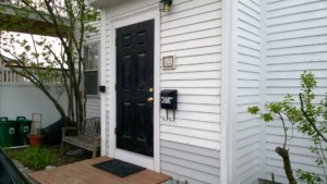 our front door after 1 coat of black semi-gloss behr paint