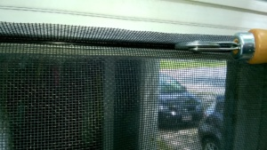 using spline and a spline roller to attach the front hall replacement screen