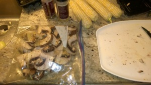 shaking up the sliced portobellos with olive oil & seasonings