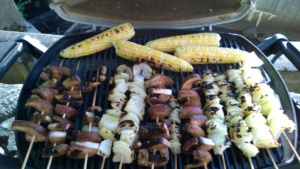 grilling skewered onions, skewered portobellos, and corn on the cob