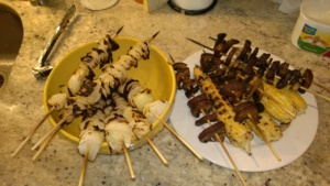 grilled skewered onions, skewered portobellos, and corn on the cob