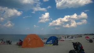 crane beach tents and clouds