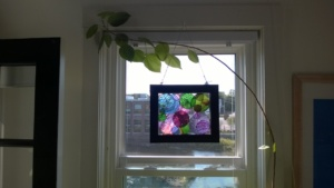 my first stained glass circles project hung in the bedroom window