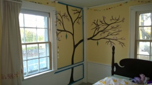 i painted a full cherry blossom tree on abbie's wall