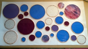 today i foiled and soldered the edges of my 27 stained glass circles