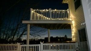 i strung LED christmas lights on our deck