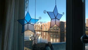 i soldered spirals to 3 of the large stained glass stars i made last december