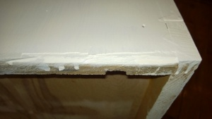 the bottom edges of the bookcase need some work where the wood splintered off