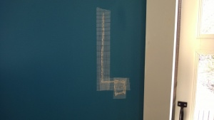 i used drywall tape to cover the hole & slice i cut in the bedroom wall